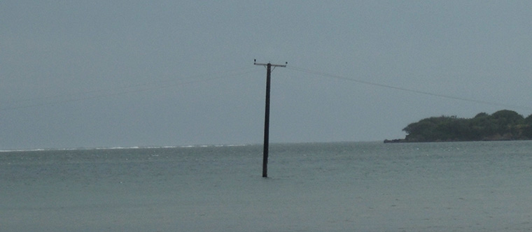 Picture of a power pole in the sea